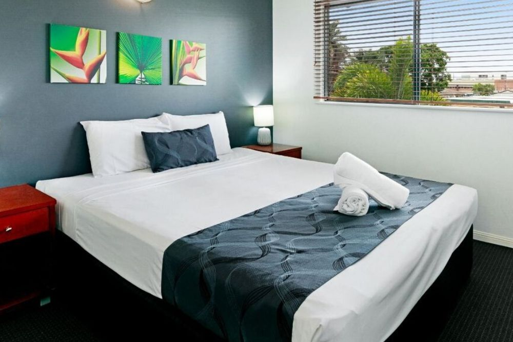 master bedroom at getaway on grafton cairns with tropical pictures
